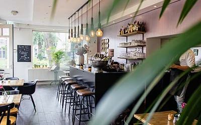 interior-shot-cafe-with-chairs-near-bar-with-wooden-tables